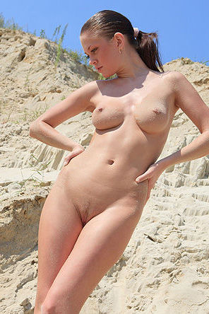 Nude Girl Posing In The Sand